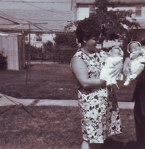 My christening, Mom says. Woman holding me stood in as godmother.