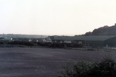 Dye Woodhams scrapyard in Barry, seen from the train. This dates from early 1980's and as can be seen its still fairly full of Steam Loco's and old wagons.