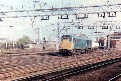 31199 on a freight from Temple Mills passing Stratford  21/09/84.
