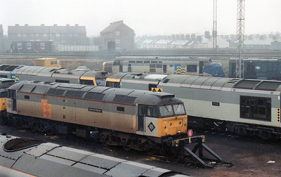 47283 'Johnnie Walker' at Cardiff Canton. Withdrawn 37273 can be seen sheeted up in the background.