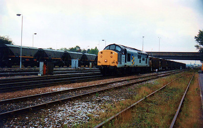 37716 leaves Toton on a rake of sea cows heading north.