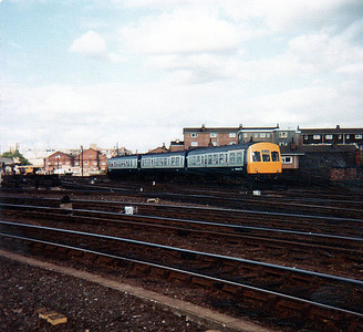 An UID DMU heads south out of York.