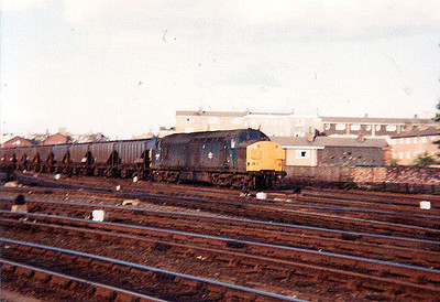 An UID Class 37 heads south through York station on a freight working.