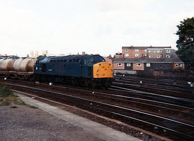 40033 'Empress of England' comes of York avoider with 4w tanks heading south.
