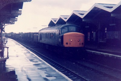 Unidentified Class 45 on a mixed freight/Speedlink heading east through March Station