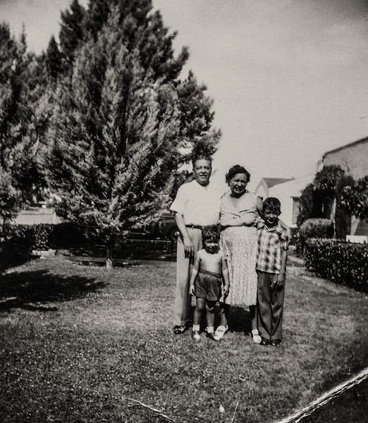Sort ID: 1954-01 Image ID: B021 (est) Year: 1954. Photo content: Dad, Fred. Mother, Edward. Location of photo: In front of 1231 E Edison St, Tucson.