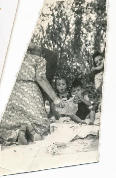 Sort ID: 1944-01 Image ID: C369 Year: 1944. Picnic scene with Cruz, mother, and two Gabusi children.