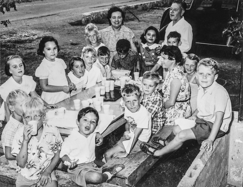 Sort ID: 1952-A01 Image ID: A021 Year: 1952 Photo content: Edward, Margaret, Fred Location of photo: Birthday party for Edward in Cardon, Venezuela; see a related photo: image A006. Boy with mother's arms around him is Tony Robertson, Ed's best friend. Shiela Oatts is the woman on right, a teacher of Ed's class at the Cardon Elementary School.