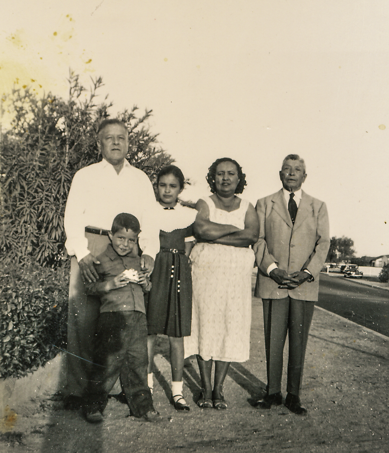 Sort ID: 1954-01 Image ID: B083 (est) Year: 1954. Photo content: Dad, Fred, Margaret, mother, grandpa Mucio. Location of photo: On the street in front of 1225 E Edison St, Tucson.
