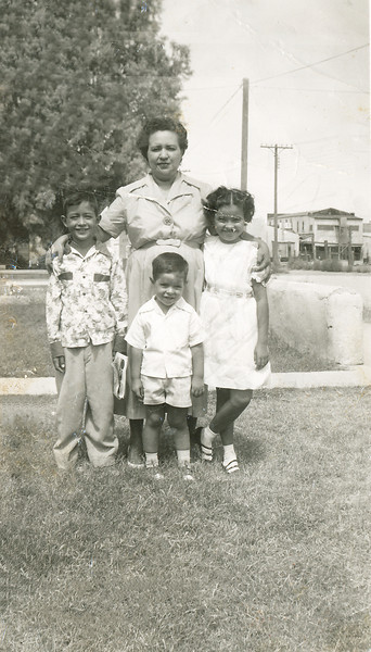 Sort ID: 1952-015 Image ID: C568 (est) Year: 1952. Edward, mother, Fred, Margaret standing in front of Mamagrande's house in Florence AZ.