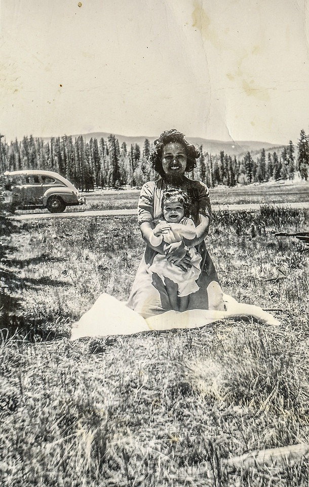 Sort ID: 1943-A05 Image ID: C223 est Year: 1943 Photo content: Mother holding Margaret; Location of photo: looks like somewhere in the White Mountains?