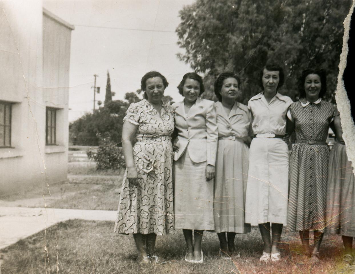 Sort ID: 1952-01 Image ID: M017.  Mary Ortega Gabusi, Teresa Ortega, Sara Ortega Delgado, Josephine Ortega May, Carmela Ortega Silvas. Taken in front of mamagrande's house in Florence, AZ.