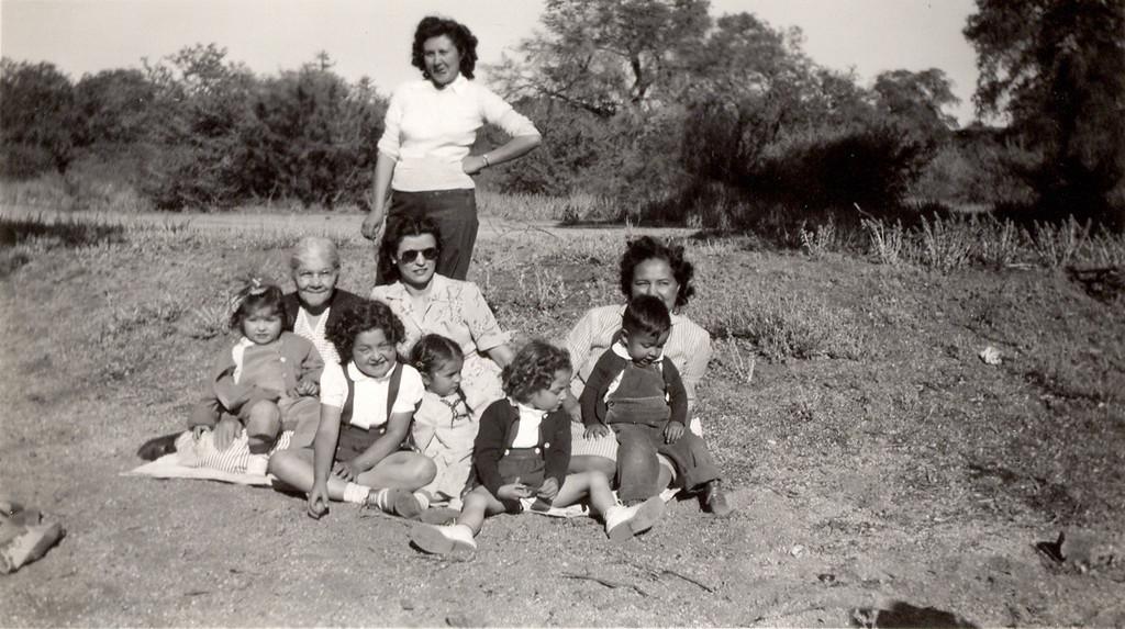 Sort ID: 1947-A08 Image ID: D012 (est) Year: 1947. Photo content: Cecilia Ann, Cruz, Flora, Annie, Clara, Peggy, Mary Helen, Edward, Sara Location of photo: Arizona.