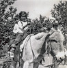 Sort ID: 1948-01 Image ID: D070 (est) Year: 1948. Photo content: Margaret & Edward on a horse. Location of photo: Ranch at Oracle, Arizona.