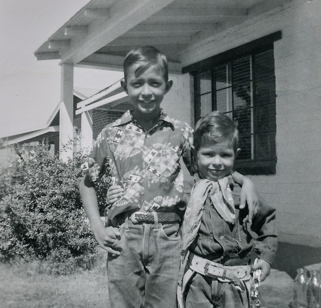 Sort ID: 1954-10  Image ID: C559 Year: 1954 (October). Edward and Fred in front of 1225 E Edison in Tucson.
