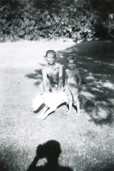 """Sort ID: 1958-s Image ID: C579  Year: 1958 (summer). Fred and Mike playing with Pinto in front of 1231 E Edison St, Tucson. Inscription on back: """"Summer 1958.  Mikey 3, Freddy 9, Pinto."""""""