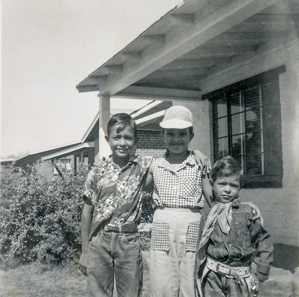 Sort ID: 1954-10 Image ID: C577 Year: 1954 October. Edward, Margaret, and Fred in front of 1225 E Edison St, Tucson.