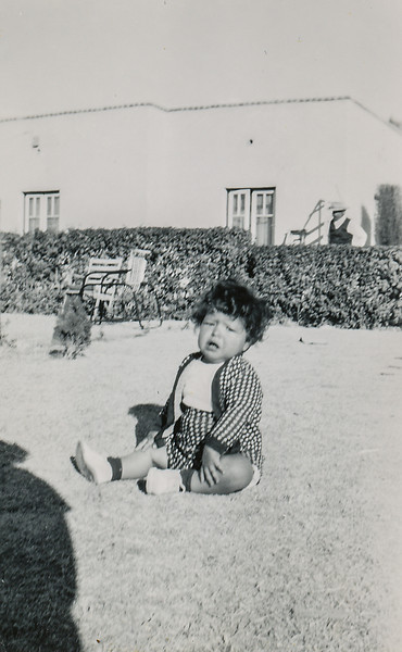 Sort ID: 1950-E01 Image ID: C578 (est) Year: 1950. Fred in front of 1225 E Edison St, Tucson. See related photo B016.