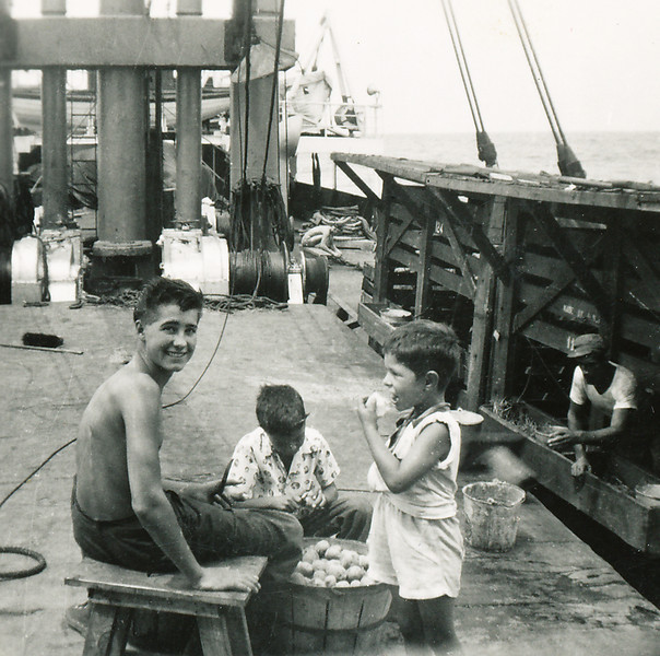 Sort ID: 1954-S003 Image ID: C572 (est) Year: 1954. Fred and Edward learned to eat raw potatoes on this ship. Edward remembers this deck-hand as a fellow from Holland or Norway who spoke no English. He may have been 15 years-old.