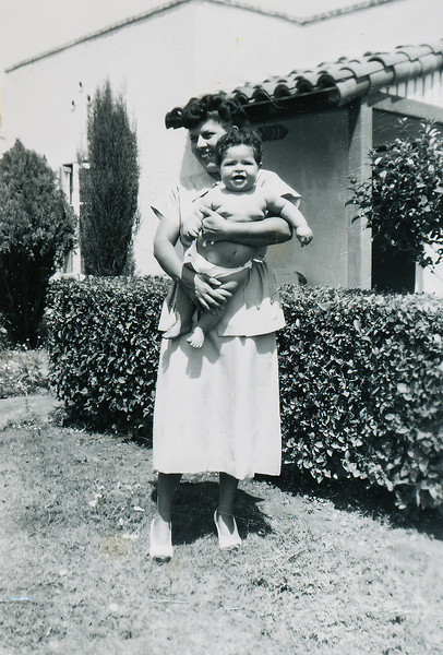 Sort ID: 1949-B03 Image ID: B046 (est) Year: 1949. Photo content: Aunt Conchita holding Fred. Location of photo: In front of 1231 E Edison St, Tucson.