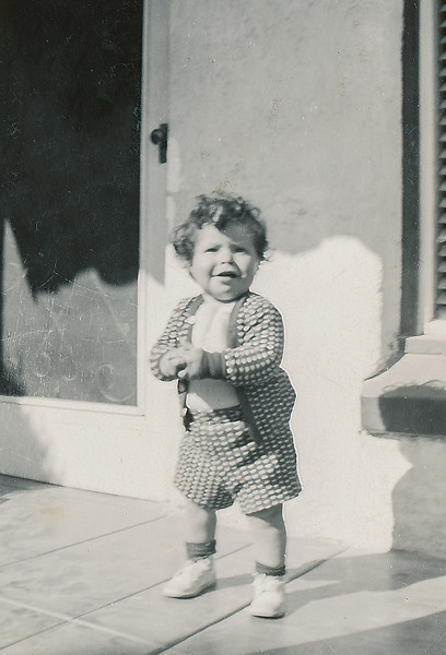 Sort ID: 1950-A01 Image ID: C590 (est) Year: 1950.  Fred in front of 1231 E Edison St, Tucson.