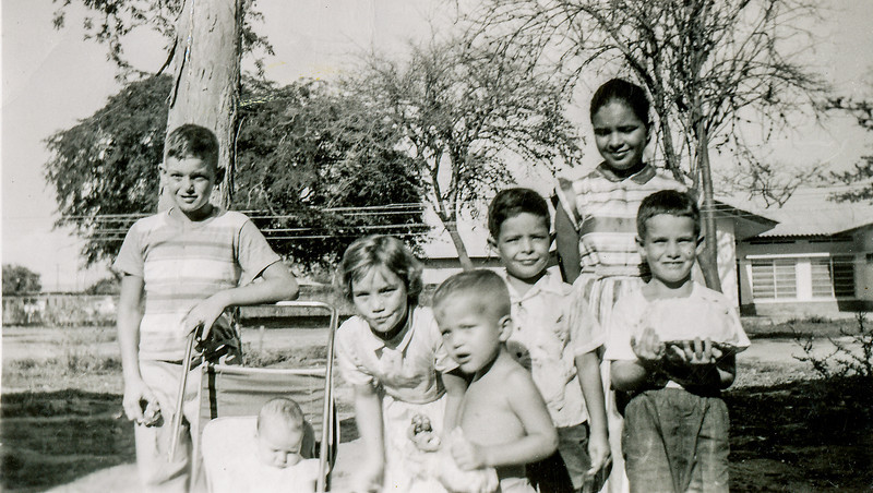 Sort ID: 1954-V06A Image ID: C573 (est) Year: 1954. Fred and Margaret with children in Las Morochas, Venezuela.  Boy at far right may be John Incledon. The occasion may have been a birthday party for John.