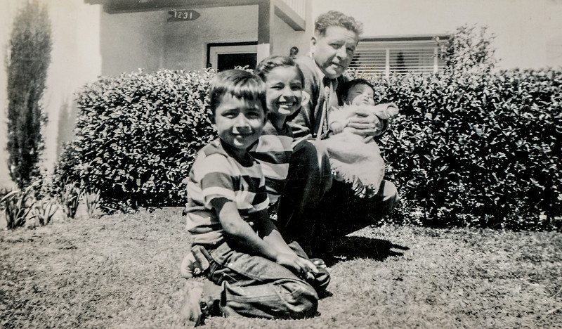 Sort ID: 1949-008 Image ID: C562 (est) Year: 1949. In front of 1231 E Edison St, Tucson: Edward, Margaret, Dad, and Fred.