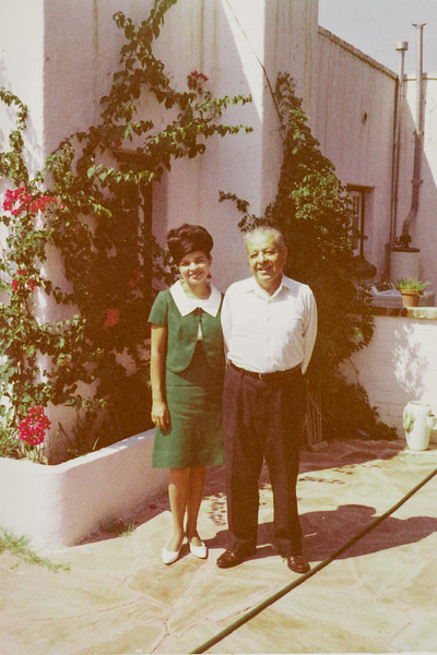 Sort ID: 1968-015 Image ID: C567 (est) Year: 1968. Margaret and Dad standing in front of 1231 E Edison St, Tucson.