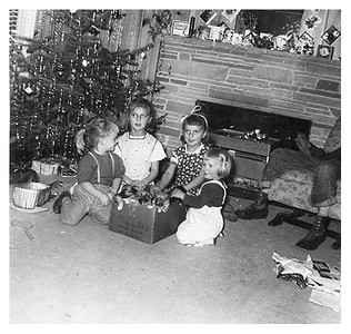 Mary and Margaret Coble. I think that is Eddie Coble in the chair to the right.  He was Dad's friend from before he married Mom.   Our dog had 5 puppies.  The father was probably the Canfield's cocker spaniel.  She got calcium deficiency paralysis from trying to feed all of them.  I remember her not being able to walk and I remember the vet coming and giving her a shot.