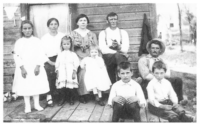 Early picture of Gelaude family.  I think the other family is Grandpa's brother Phil and his family.