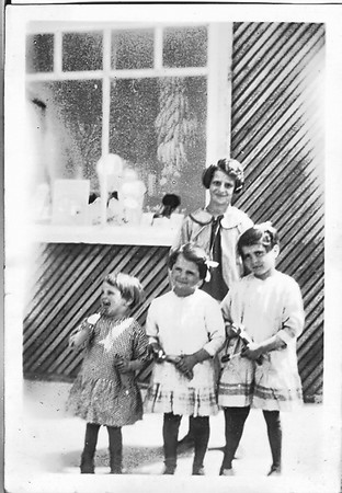 Clarice with Jessie, Martha and Maria in front of Pop's store.  See the bananas in the window.