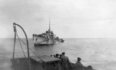 "Photo taken from the HMCS Chambly (Avalon)  From www.rcnvr.com:  ""HMCS Chebogue (River Class Frigate - K317) was torpedoed by U-1227 on 4 October 1944, 800 miles west of Ireland. She was towed some 900 miles first by HMCS Chambly, then HMS Mounsey, then HMCS Ribble and the ocean tug HMS Earner when, on October 11, 1944;, the towline parted in a gale and HMCS Chebogue was driven ashore in Swansea Bay Wales. She was refloated the next day and towed to Port Talbot, Wales, and placed in reserve. In December 1944, she was moved to Newport, Wales, to be made ready for a transatlantic crossing under tow but instead was taken to Milford Haven and paid off on September 25th 1945. She was broken up locally in 1948. From page 250 of ""The Canadian Naval Chronicle 1939-1945"" and page 45 of ""The Ships of Canada's Naval Forces 1910-1981"""