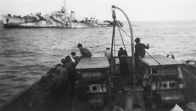 "Photo taken from the HMCS Chambly (Avalon)  From www.rcnvr.com:  ""HMCS Chebogue (River Class Frigate - K317) was torpedoed by U-1227 on 4 October 1944, 800 miles west of Ireland. She was towed some 900 miles first by HMCS Chambly, then HMS Mounsey, then HMCS Ribble and the ocean tug HMS Earner when, on October 11, 1944;, the towline parted in a gale and HMCS Chebogue was driven ashore in Swansea Bay Wales. She was refloated the next day and towed to Port Talbot, Wales, and placed in reserve. In December 1944, she was moved to Newport, Wales, to be made ready for a transatlantic crossing under tow but instead was taken to Milford Haven and paid off on September 25th 1945. She was broken up locally in 1948. From page 250 of ""The Canadian Naval Chronicle 1939-1945"" and page 45 of ""The Ships of Canada's Naval Forces 1910-1981""."