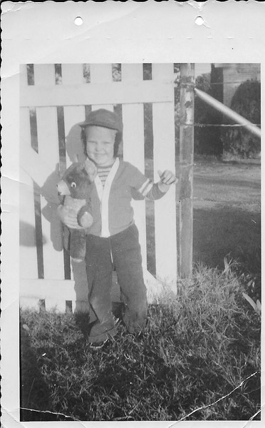 Ronnie Humphries standing by the garden gate at Spring Hill homeplace.  With my favorites teddy bear.   I was 3 1/2 years here.