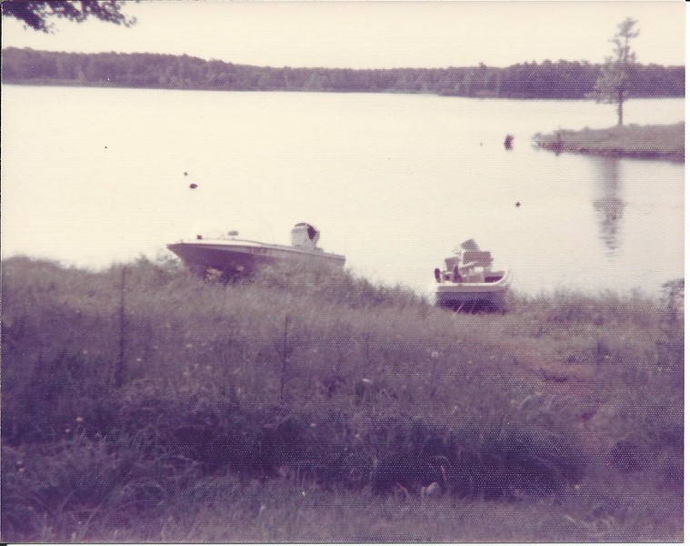 We used to camp a lot at this lake  Can see our boat on the left.  We used to water ski behind this boat.  Boat on right, not sure.