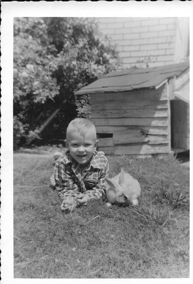 Here I am with my pet rabbit.  In the background you can see the dog house of my pet dog, Mikey Diddle.