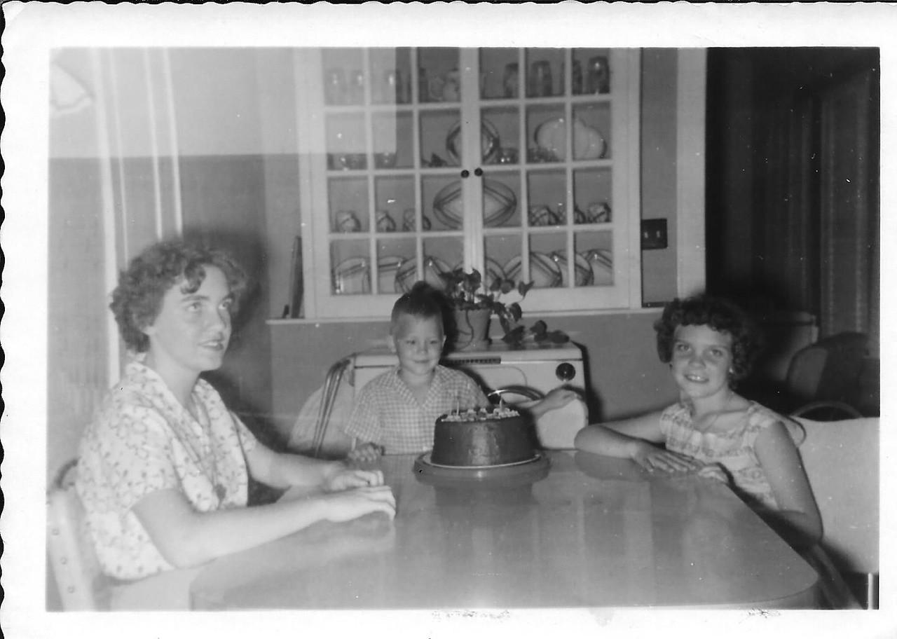 Barbara and Martha Tekell, with evidently Birthday boy, Ronnie Humphries. Taken on Ronnie's 6th birthday.  Barbara 12, Martha 8, Ronnie 6.