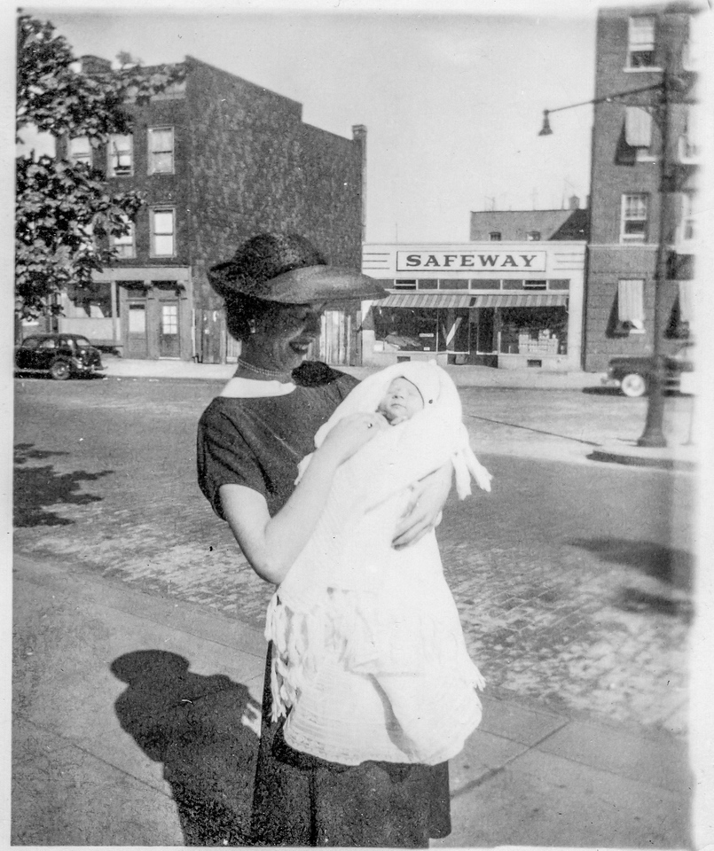 Patricia O'Brien holding Paul Brady on christening at Sacred Heart Church, Bronx, NY