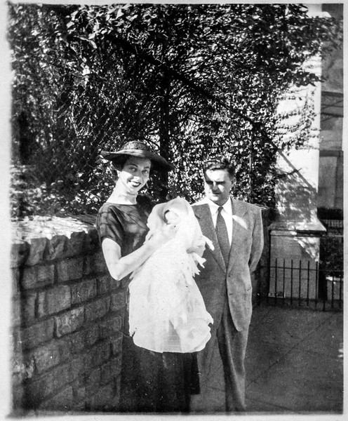 Patricia O'Brien holding Paul Brady and Michael Treat, godparents