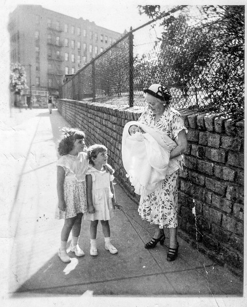 Mary Brady holding Paul Brady with Bernadette and Jeanne Treat