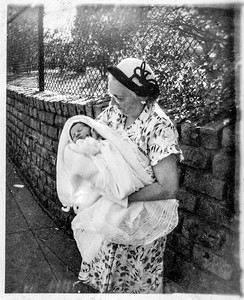 Mary Brady holding Paul Brady, grandson