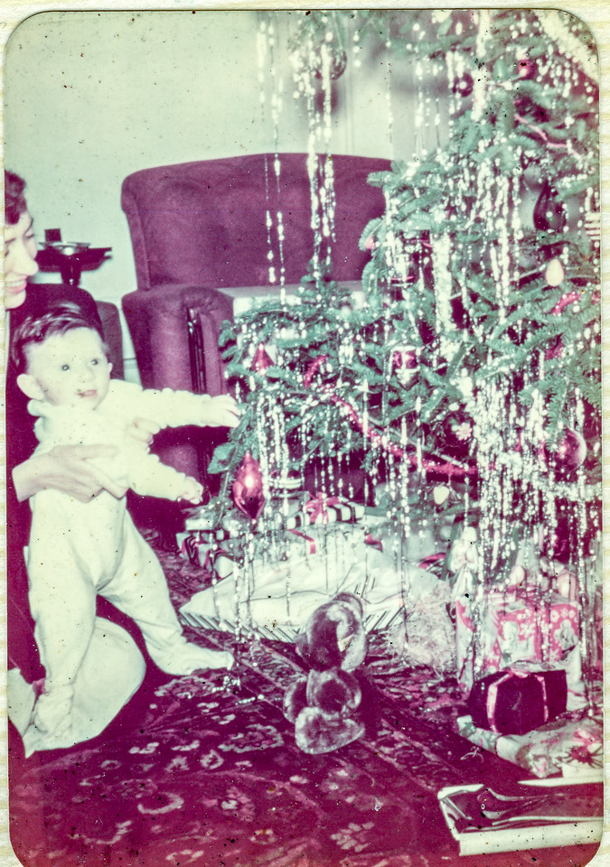 Elizabeth Brady holding Paul Brady first Christmas