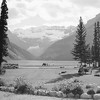 Lake Louise with poppies in foreground.