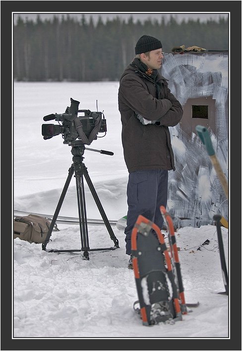 Camera man waiting for action. <br /> <br /> Filming for Grouse documentary, Koskenpää, March 2004