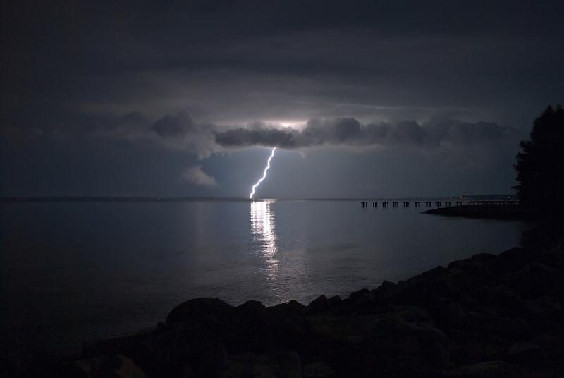Single bolt of lightning on the Ross Barnette Reservoir near Jackson, Mississippi taken from the Brandon side of the spillway.