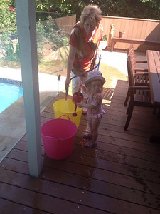 Scarlett enjoying the water with Nanna on a hot November day with bush fires blazing just down the road... November 2013