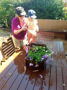 Scarlett and Nanna watering the Flowers - Age 18 Months