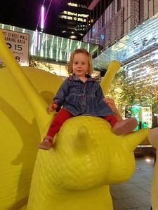 Scarlett 'riding the snail' after dinner at La Rosa...