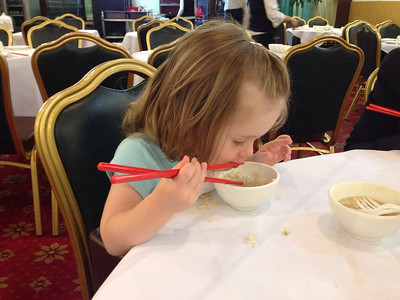 Scarlett's first attempt at eating with chop sticks. Age 1 year, 11 months at Eastwood, Sydney.