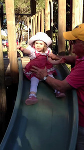 Scarlett enjoying a slippery dip with 'pops' after a long lunch at Pilu, Freshwater (September 2013: Age 19 Months)